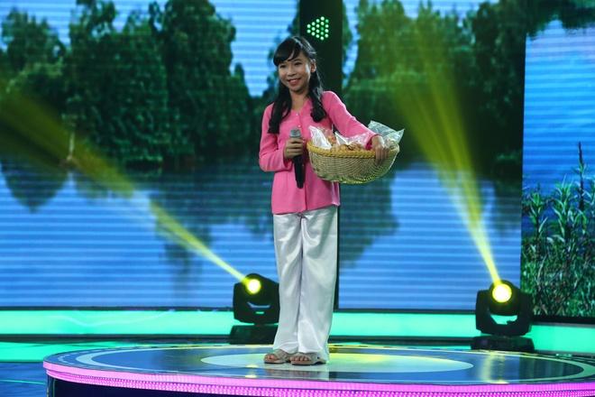 Be 9 tuoi duoc Quang Linh vi la 'ban sao nhi' Tung Duong hinh anh 9
