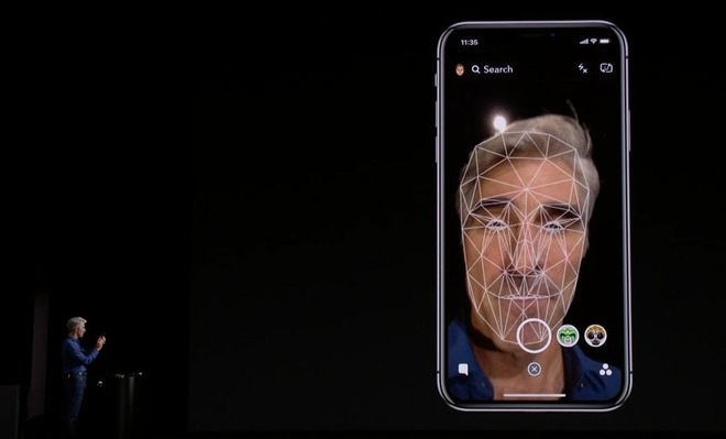 FaceID tren iPhone X 'bo tay' truoc cac cap song sinh hinh anh 1
