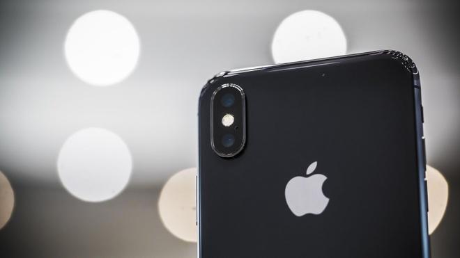Apple bi kien vi su dung camera kep tren iPhone hinh anh 1