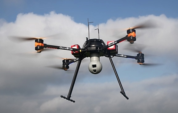 Cong ty Nhat che tao drone 'duoi' nhan vien ra ve dung gio hinh anh