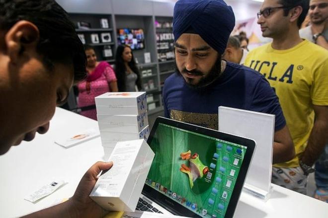 Apple the tham - chi tai iPhone qua dat hinh anh 3
