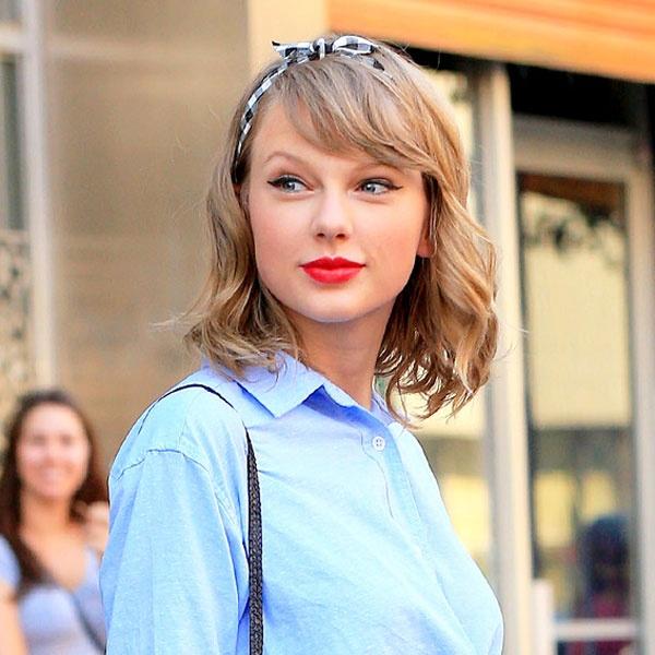 Taylor Swift dang yeu qua tung kieu toc hinh anh 1