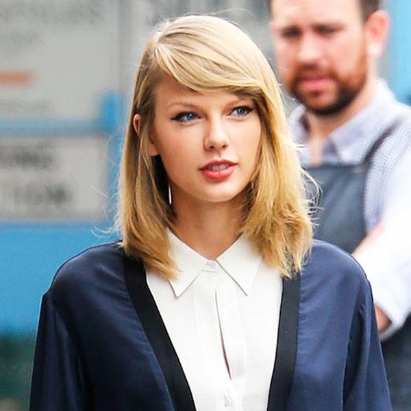 Taylor Swift dang yeu qua tung kieu toc hinh anh 2