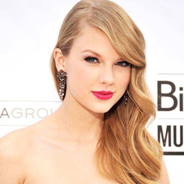 Taylor Swift dang yeu qua tung kieu toc hinh anh 7