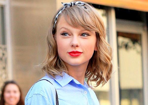 Taylor Swift dang yeu qua tung kieu toc hinh anh