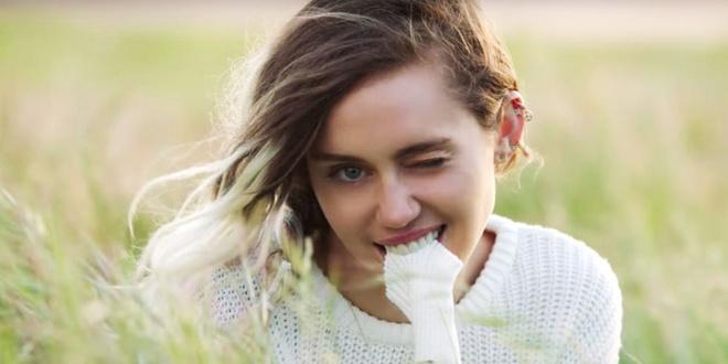 Miley Cyrus diu dang sau nhung ngay noi loan hinh anh 3