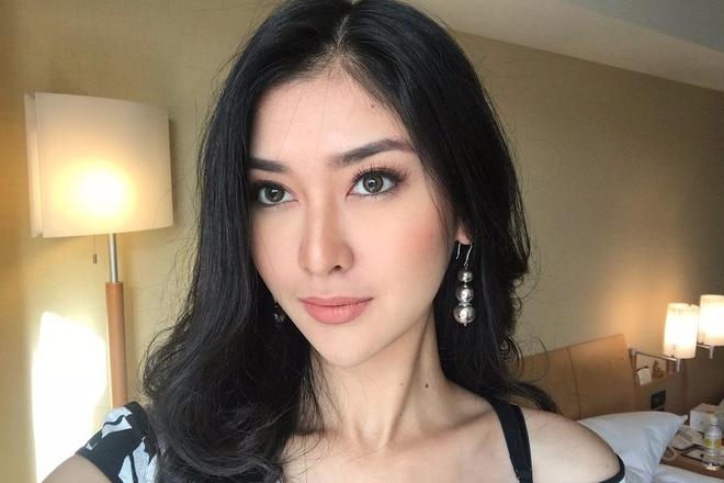 Nhan sac doi thuong cua tan Hoa hau Quoc te 21 tuoi hinh anh