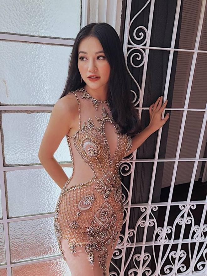 Voc dang goi cam cua nguoi dep Viet dang thi Hoa hau Trai dat 2018 hinh anh 5