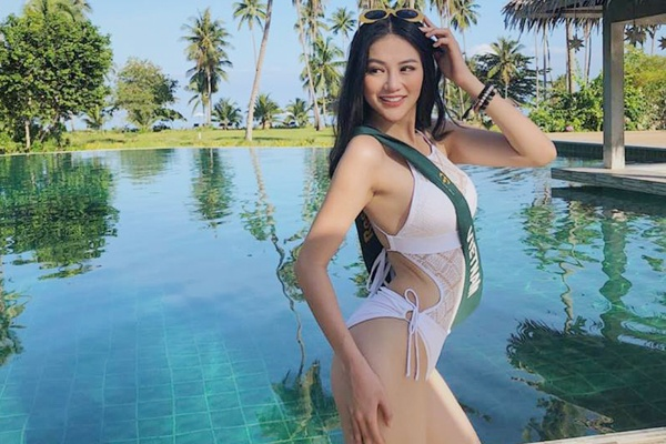 Phuong Khanh chon dam cut-out goi cam cho chung ket Hoa hau Trai dat hinh anh