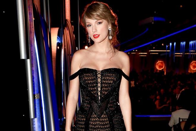 Taylor Swift mac goi cam, xuat hien bat ngo o Qua cau vang 2019 hinh anh