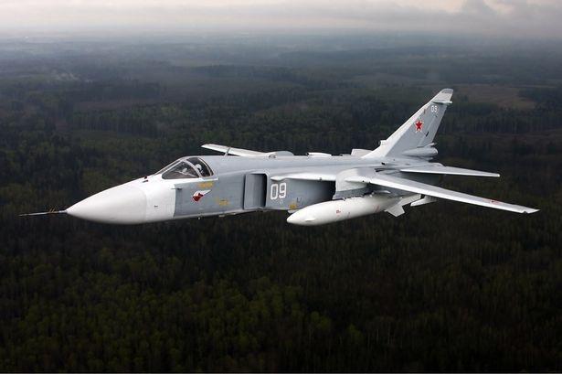 Su-24 Syria bat ngo xuat kich, suyt dung do khong quan Anh hinh anh