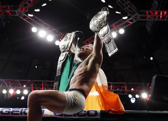 Ha knock-out doi thu, 'ga dien' McGregor di vao lich su UFC hinh anh 7