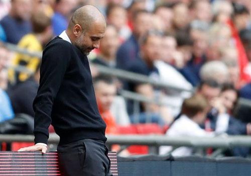 'Guardiola an toan du Man City khong du Champions League' hinh anh