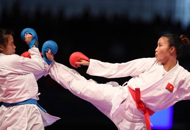 SEA Games 22/8: Hong Anh danh bai vo si chu nha, gianh HCV du bi xu ep hinh anh