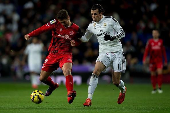 Ha Sevilla 2-1, Real gia tang cach biet voi Barca len 4 diem hinh anh 13