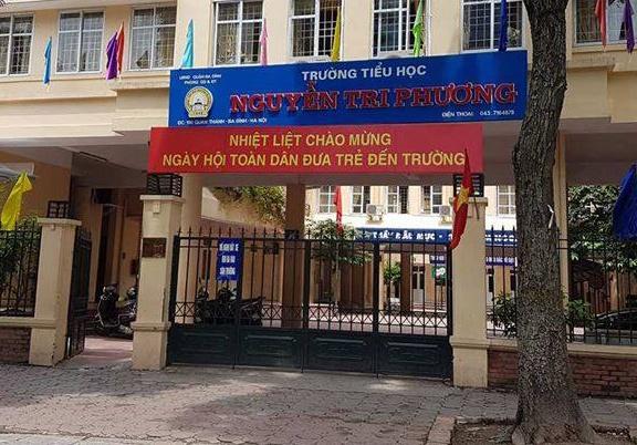 Chu tich Nguyen Duc Chung chi dao lam ro vu co giao danh 11 hoc sinh hinh anh