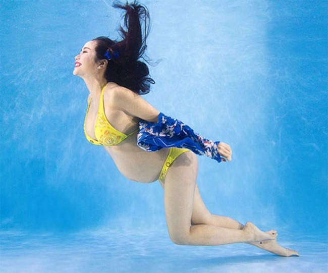 Kieu nu showbiz Viet mang bau van dien bikini goi cam hinh anh