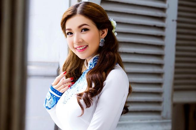 Pham Thanh Thao tre trung voi ao dai trang hinh anh 7