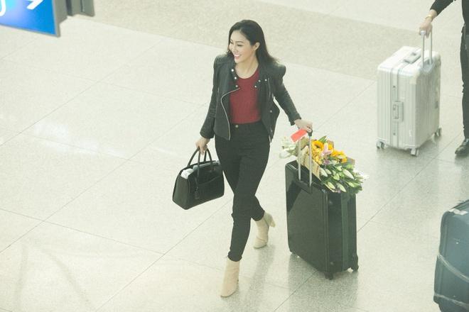 Dieu Ngoc mang 100 kg hanh ly du thi Miss World hinh anh 4