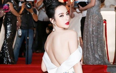 Angela Phuong Trinh khoe lung tran tren tham do hinh anh