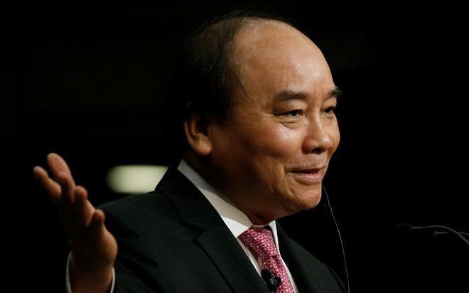 Thu tuong: Khong de tai dien vu phat tien khi doi 100 USD hinh anh