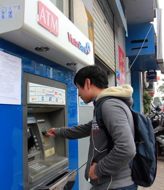 Sau Agribank, den luot Vietinbank va BIDV tang phi rut tien ATM hinh anh 1