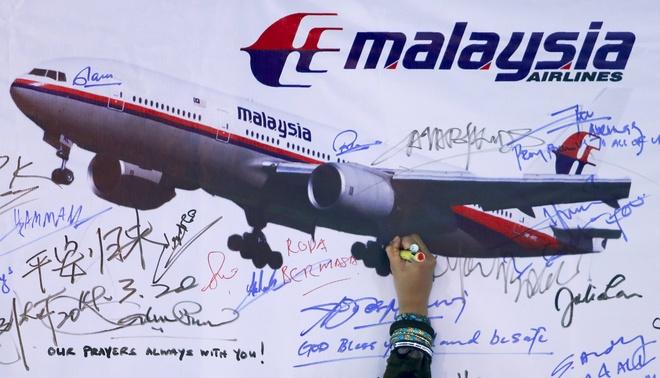 Bat cap vo chong rut 35.000 USD cua nan nhan MH370 hinh anh