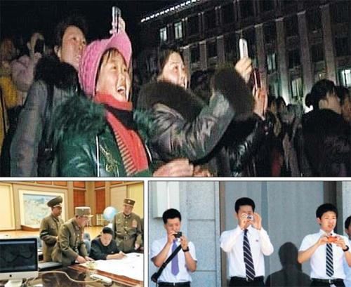 Mot xai iPhone cua nguoi giau Trieu Tien hinh anh 1 Ảnh chụp màn hình từ các bản tin của truyền hình trung ương Triều Tiên cho thấy nhiều người dân đang dùng điện thoại thông minh để chụp ảnh, còn trên bàn làm việc của nhà lãnh đạo Kim Jong Un là một chiếc iMac. Ảnh: Chosun Ilbo