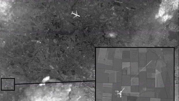 Anh chan dong ve MH17 cua Nga bi to la gia hinh anh 1 Bức ảnh do đài truyền hình Nga công bố. Ảnh: Channel One