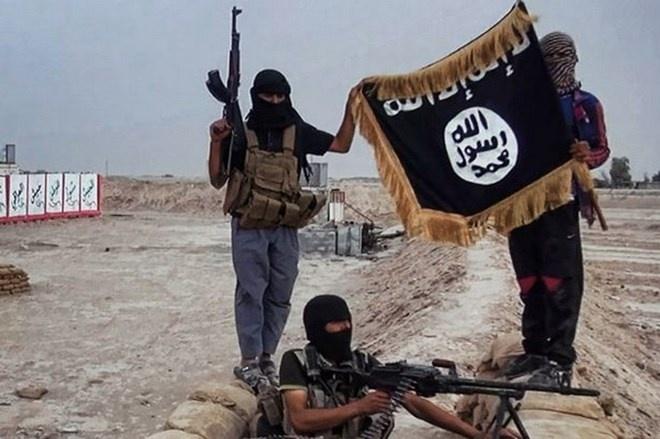 Phien quan IS chat dau 4 tre em Iraq khong chiu cai dao Hoi hinh anh