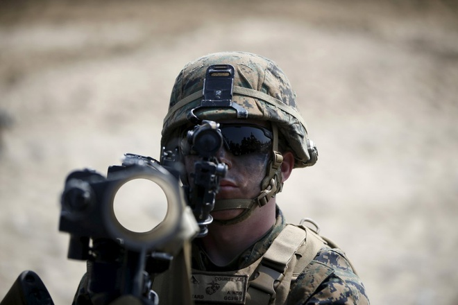 Một lính thủy đánh bộ Mỹ tham gia tập trận đổ bộ tại Pohang ngày 30/3. Triều Tiên cáo buộc Hàn Quốc và Mỹ lấy cớ tập trận quân sự để âm thầm chuẩn bị lực lượng phát động chiến tranh.
