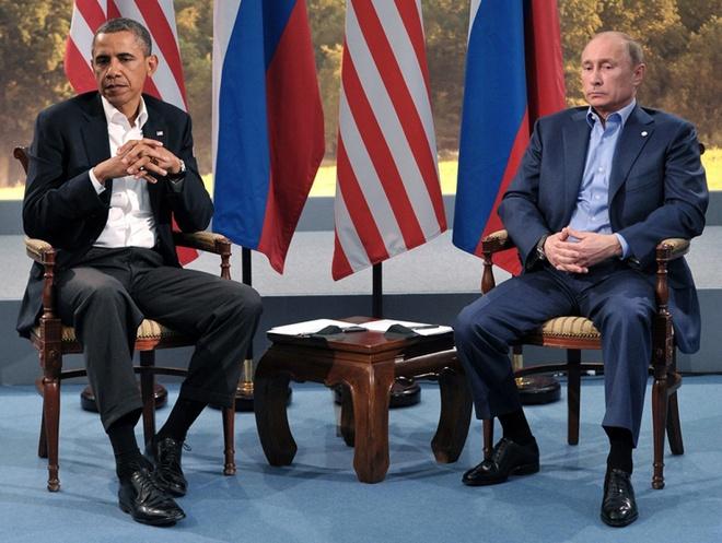 Vi sao cuoc gap giua Obama va Putin la buoc dot pha? hinh anh 3 Nét mặt của ông Obama và Putin cho thấy rõ những bất đồng trong quan hệ hai nước tại cuộc họp bên lề Hội nghị Thượng đỉnh G8 ở Bắc Ireland năm 2013. Ảnh: E