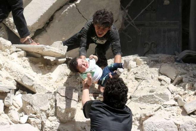 Benh vien bi khong kich, lenh ngung ban o Syria 'thoi thop' hinh anh 1