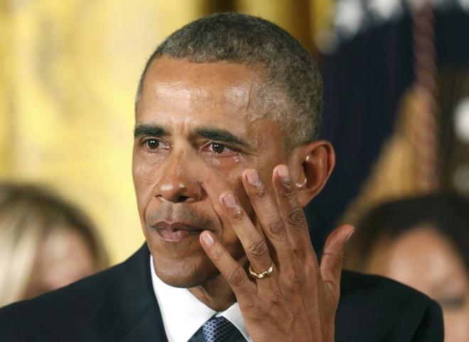 Giot nuoc mat bat luc cua ong Obama sau cac vu xa sung o My hinh anh
