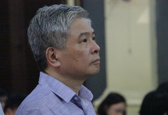 Nguyen Pho thong doc Ngan hang Nha nuoc phu nhan cao trang truy to hinh anh