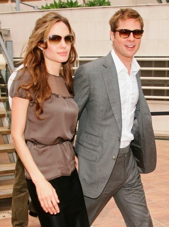 Angelina se tiet lo chuyen phong the 3 nguoi cung Brad Pitt? hinh anh 1