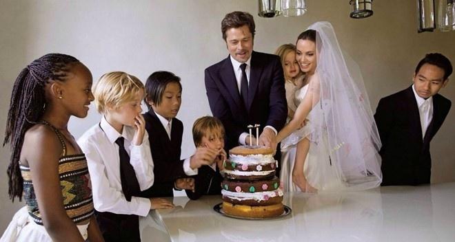 Angelina se tiet lo chuyen phong the 3 nguoi cung Brad Pitt? hinh anh 2