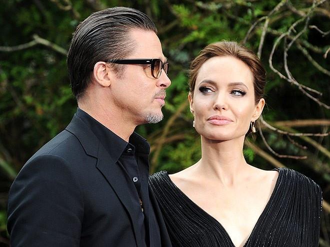 Angelina va Brad lien tuc ban nha sau khi de don ly hon hinh anh