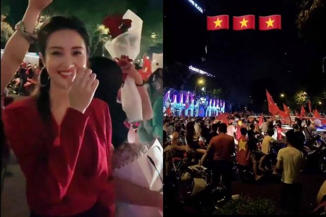 """Người đẹp Jun Vũ không thể đón được xe sau chiến thắng của tuyển Việt Nam. Trên Instagram, cô chia sẻ hình ảnh dòng với cờ đỏ sao vàng. """"Việt Nam vô địch"""", Jun Vũ nhấn mạnh."""