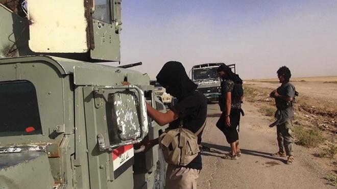 IS hiện đang giam giữ hai con tin người Mỹ và một số con tin người Anh. Ảnh: AFP