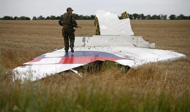 Quan sat vien nho lai ngay dau o hien truong MH17 hinh anh