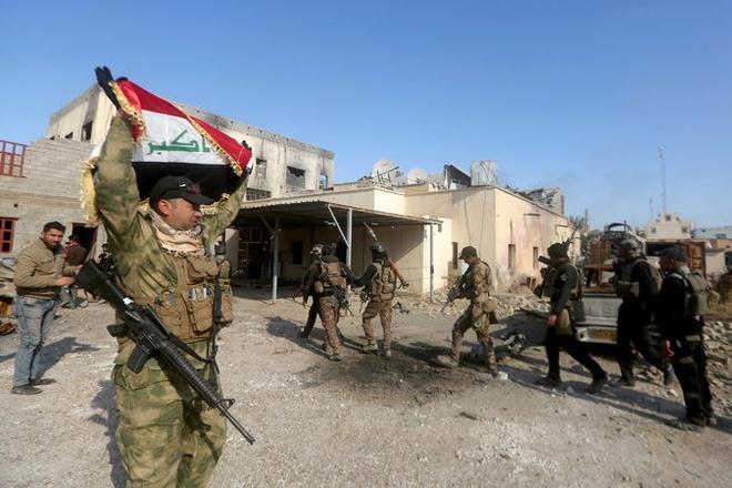 Quan doi Iraq bat thu linh tai chinh cua IS hinh anh