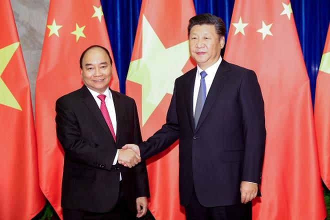 Thu tuong Nguyen Xuan Phuc hoi kien Chu tich TQ Tap Can Binh hinh anh 1
