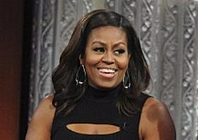 Ba Obama 'nhai giong' chong tren truyen hinh hinh anh