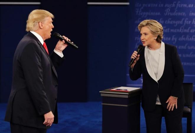 Ba Clinton lai thang trong tham do sau tranh luan lan 2 hinh anh 1