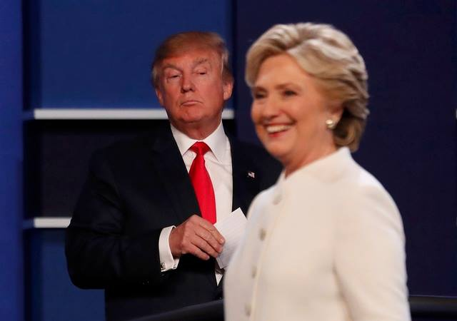Clinton: Trump la con roi cua Putin hinh anh