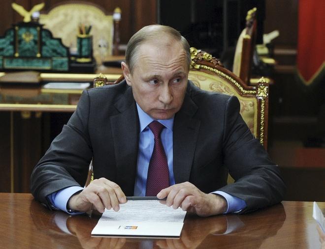Ly do ong Putin rut quan khoi Syria hinh anh