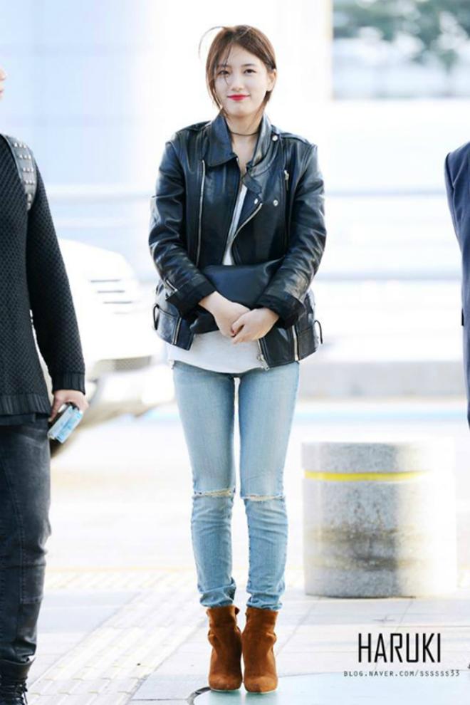 Sao Han sanh dieu voi ao khoac da hinh anh 1 Suzy sang Thái Lan để chuẩn bị cho một sự kiện vào ngày 12/10, thành viên missA xuất hiện với áo khoác da, quần jean rách và boots lửng. Lớp trang điểm nhẹ nhàng cùng làn môi đỏ tươi giúp Suzy nổi bật ở sân bay.