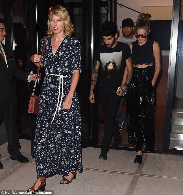 Taylor Swift lien tiep mat diem vi trang phuc hinh anh 1