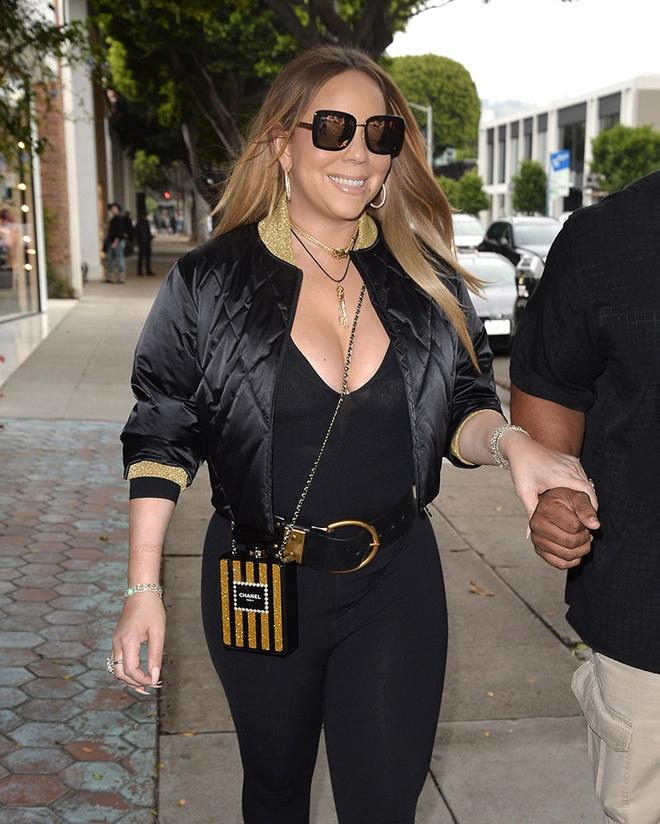 Boc gia mau tui dat do duoc Mariah Carey mang theo moi noi hinh anh 9